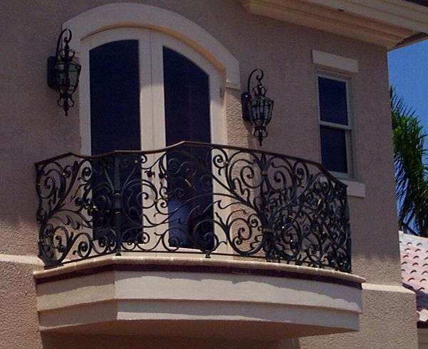 Ornamental metal railings handrails fences gates and for Balcony steel railing designs pictures